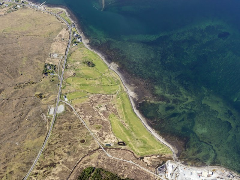 Oblique aerial view of the remains of fish traps near Sconser golf course, and the remains of Achadh Mor township, field system and lazy beds extending towards Sconser, Skye, taken from the SE.