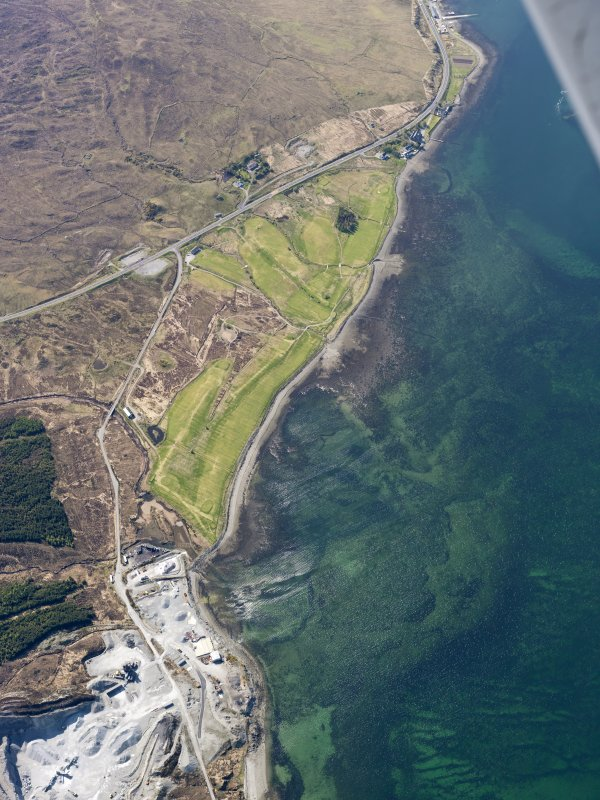 General oblique aerial view of the remains of fish traps near Sconser golf course and quarry, and the remains of Achadh Mor township, field system and lazy beds, Skye, taken from the E.