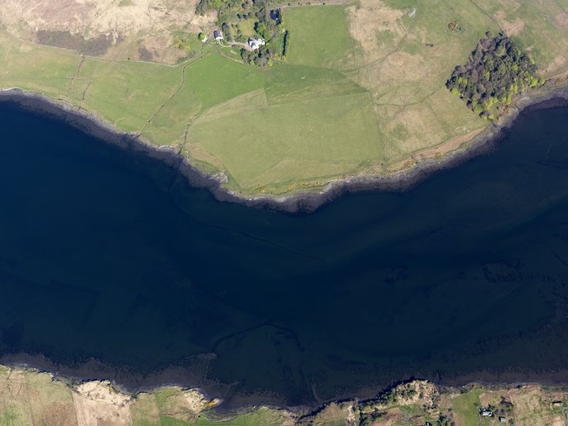 Oblique aerial view of the remains of the fish traps and kelp grids in Loch Snizort, taken from the W.