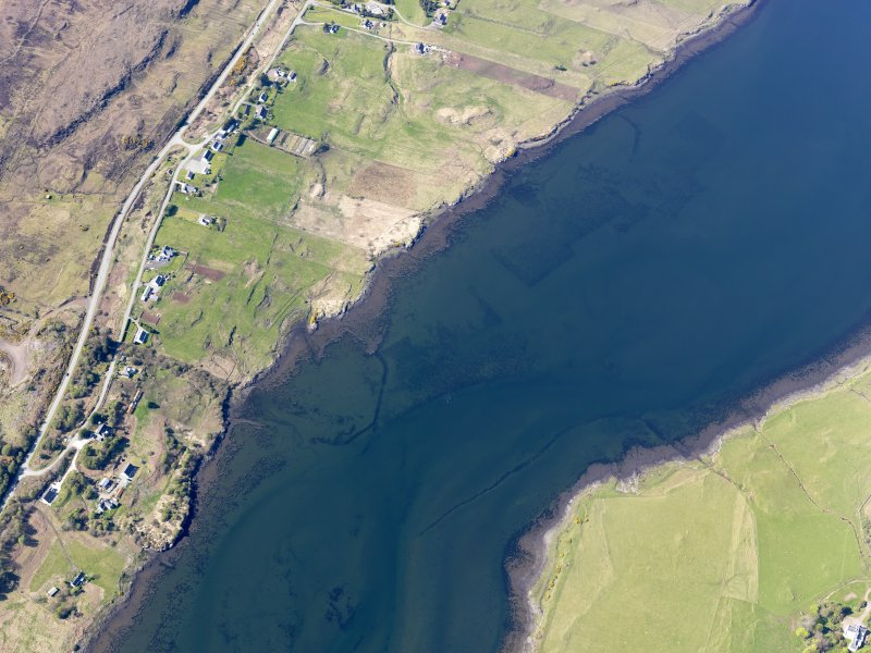 Oblique aerial view of the remains of the fish traps and kelp grids in Loch Snizort, taken from the SE.