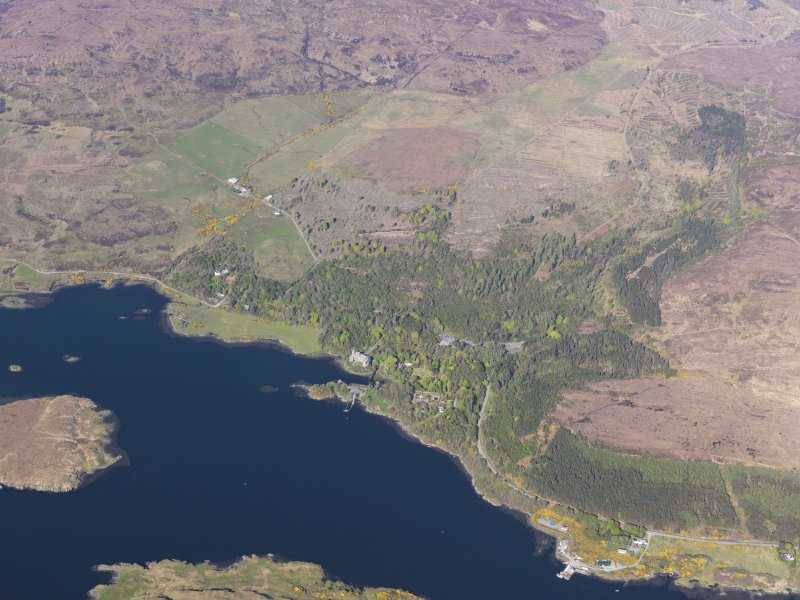 General oblique aerial view of Dunvegan Castle, with the nearby remains of field systems and lazy beds, Isle of Skye, taken from the SW.