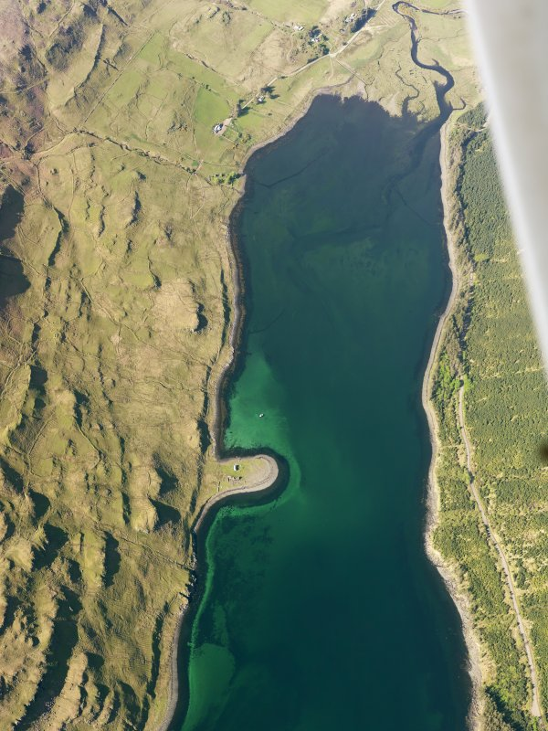 Oblique aerial view of the remains of the township, field system and lazy beds at Faolainn and the remains of a series of fishtraps at the head of Loch Eynort, Isle of Skye, taken from the S.