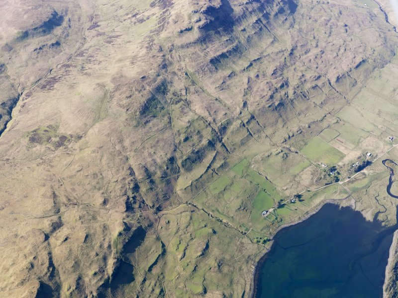 Oblique aerial view of the remains of the township, field system and lazy beds at Cnoc Loisgte and the remains of two fish traps at the head of Loch Eynort, Isle of Skye, taken from the S.