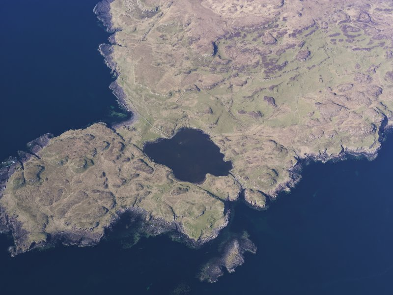 Oblique aerial view of the remains of the township, harbour and cultivation remains at Rubh' an Dunain, Isle of Skye, taken from the S.