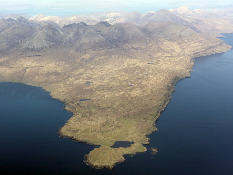 General oblique aerial view of the remains of the harbour at Rubh' an Dunain, looking towards the Cuillins, Isle of Skye, taken from the WSW.