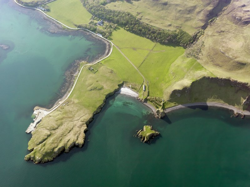 Oblique aerial view of Coroghan Castle and the pier on Canna, taken from the ESE.