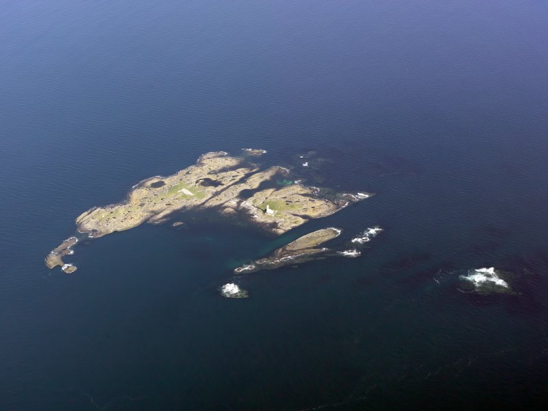 General oblique aerial view of Oigh-Skeir and the Hyskier lighthouse, taken from the NW.