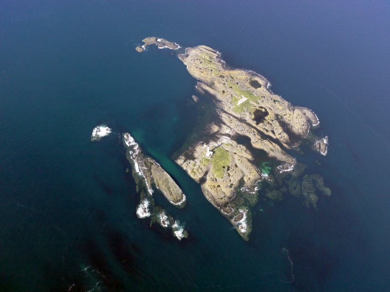 Oblique aerial view of Oigh-Skeir and the Hyskier lighthouse, taken from the SW.