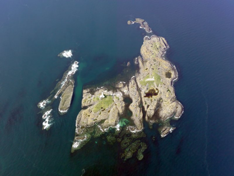 Oblique aerial view of Oigh-Skeir and the Hyskier lighthouse, taken from the S.