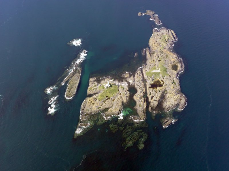Oblique aerial view of Oigh-Skeir and the Hyskier lighthouse, taken from the SSE.