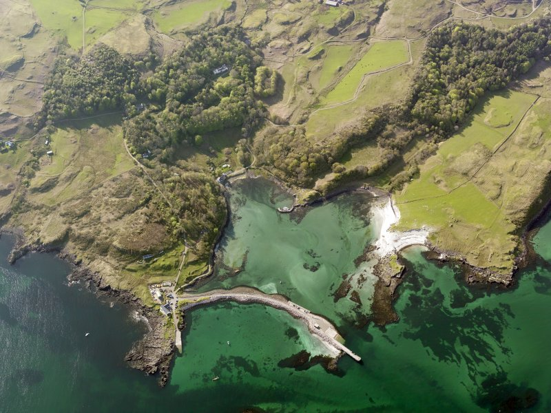 Oblique aerial view of the harbour at Eigg centred on the new slipway, taken from the ESE.