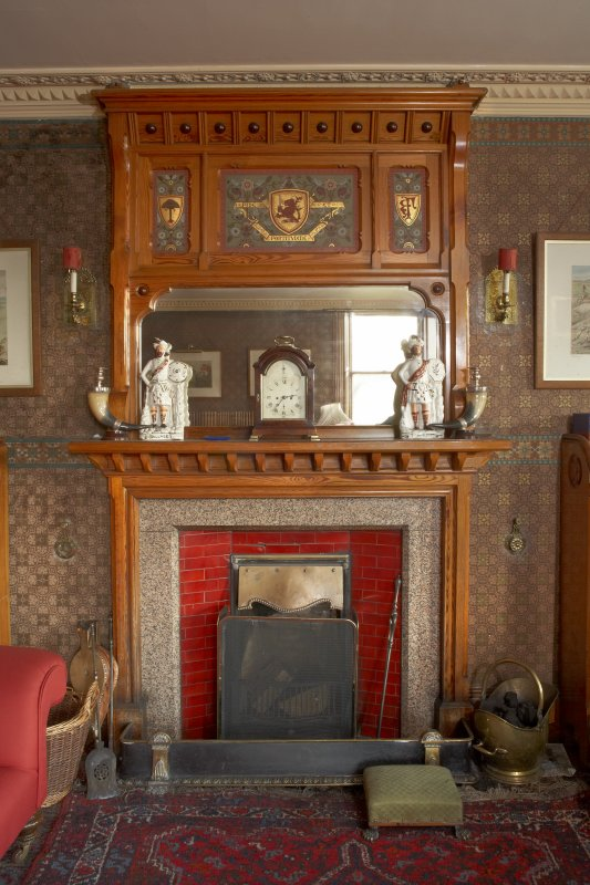 Interior. Ground floor, library, view of fireplace and overmantle