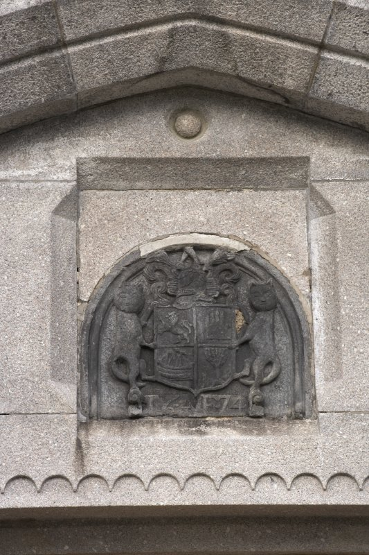 Main southeast entrance, detail of coat of arms in panel above door