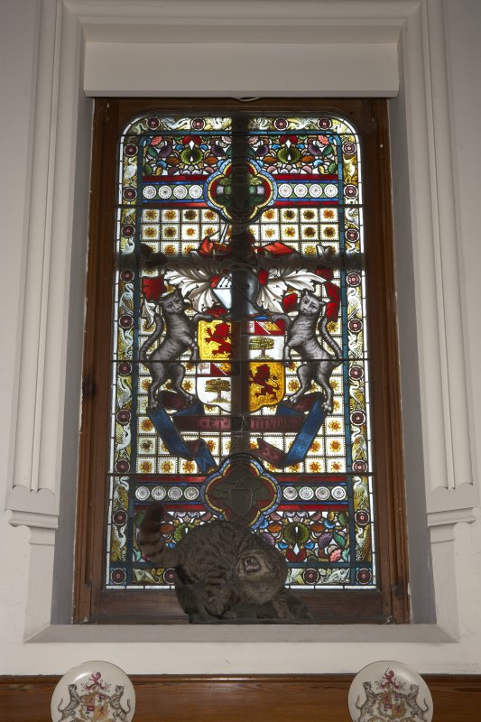 Interior.  First floor, upper hall, detail of stained window above fireplace