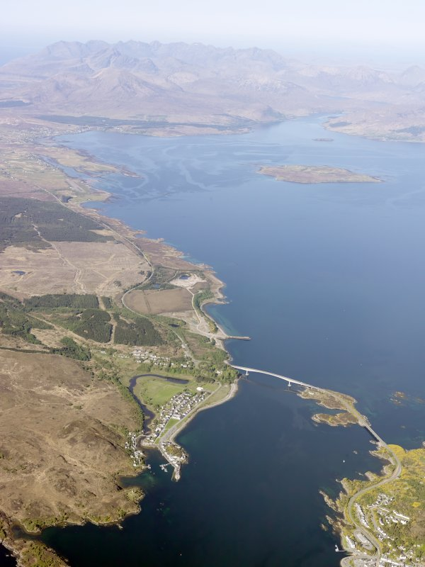 General oblique aerial view of the Skye Bridge and the Cuillin Hills in the distance, taken from the S.