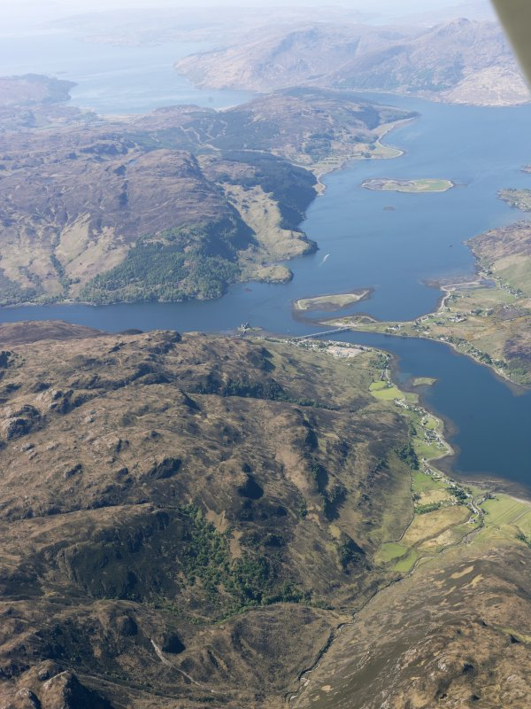 General oblique aerial view of Loch Long, Loch Alsh and Loch Duich centred on Dornie Bridge and Eilean Donan Castle, taken from the ENE.