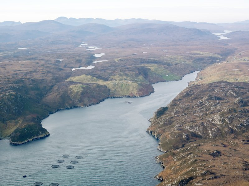 General oblique aerial view looking along Loch Odhairn towards Grabhir with the fish farm in the foreground, taken from the ENE.