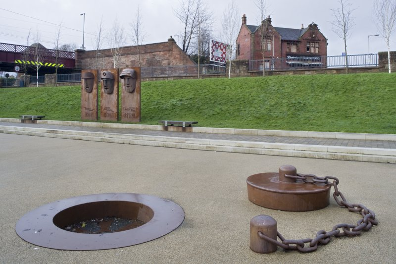 View of public art in the former basin of the Monkland Canal, with the Central Station building behind, taken from the south