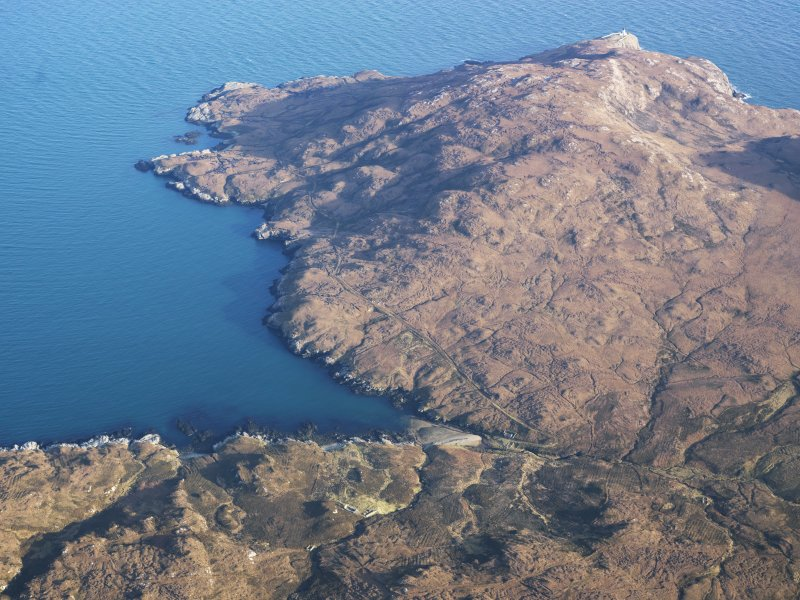 General oblique aerial view of the remains of the townships of Molatuath and Glacklee and nearby field boundaries and lazy beds, looking towards Ushenish lighthouse, S Uist, taken from the W.