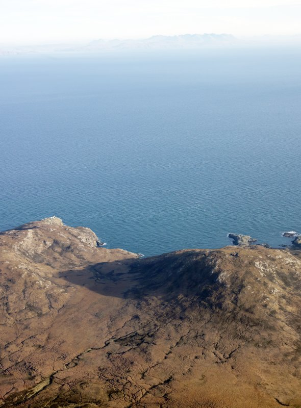 General oblique aerial view through Gleann Mile-feala towards Ushenish lighthouse, S Uist, taken from the W.