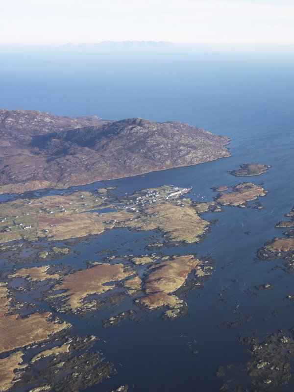 General oblique aerial view of the possible remains of a monastic settlement on Pabbay, Loch Baghasdal, looking towards Loch Boisdale, taken from the SW.