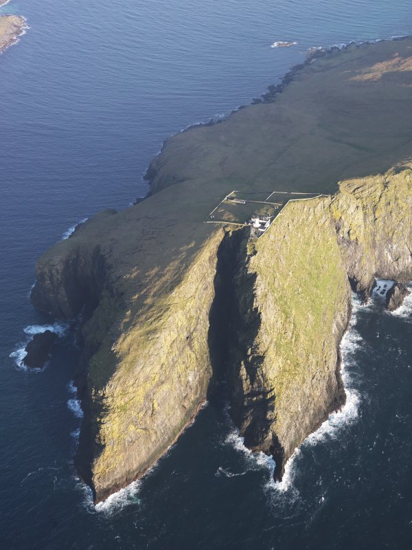 Oblique aerial view of  the remains of  Dun Briste and Sron an Duin, near Barra Head lighthouse overlooking the sea cliffs of Berneray, taken from the WSW.