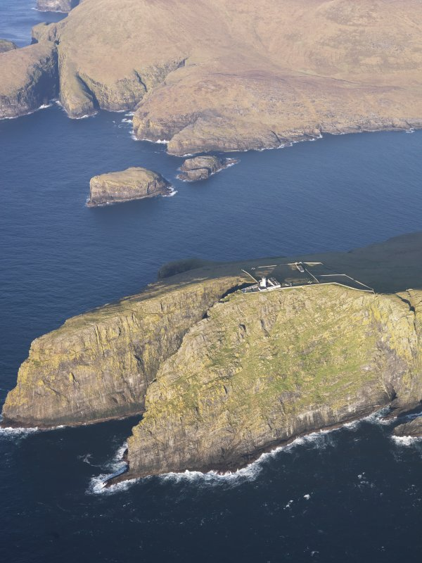 General oblique aerial view of  the remains of  Dun Briste and Sron an Duin, near Barra Head lighthouse overlooking the sea cliffs of Berneray, taken from the S.