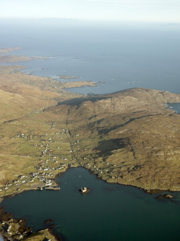 General oblique aerial view of Castlebay, looking towards the remains of the township of Brevig, Barra, taken from the WSW.