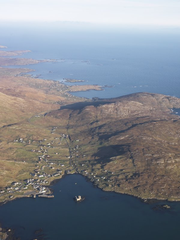 General oblique aerial view of Castlebay, looking over Kisimul Castle towards the remains of the township of Brevig, Barra, taken from the WSW.