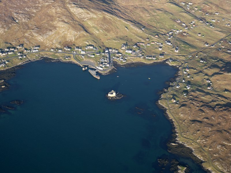 General oblique aerial view of the remains of Kiessimul Castle,Castlebay, Barra, taken from the SSW.