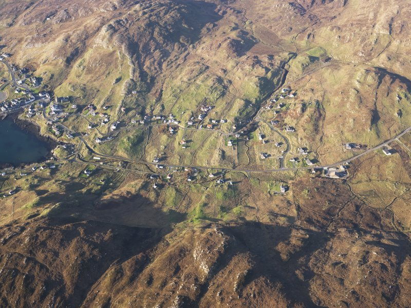 Oblique aerial view of the remains of the townships and field systems at Castlebay, Glenlots and The Glen, Castlebay, Barra, taken from the SSE.