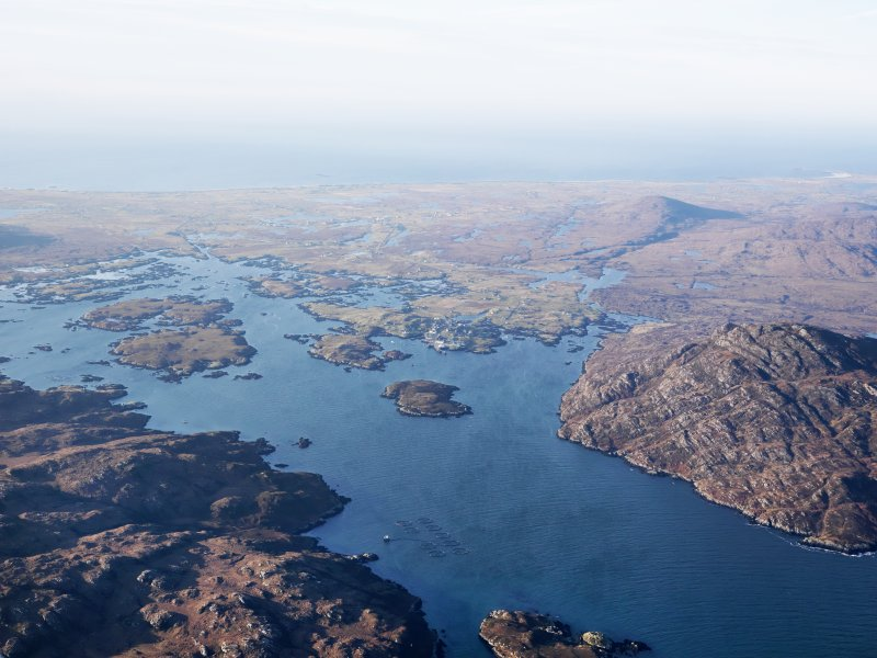 General oblique aerial view of Gasaigh, Loch Boisdale and Bein Ruigh Choinich, South Uist, taken from the SE.