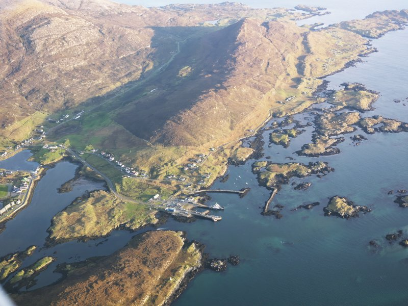 General oblique aerial view of the village and pier at Leverburgh, showing the remains of the township, fish trap, head dyke and lazy beds and the nearby remains of Dun Innisgall, Harris, taken from the WNW.