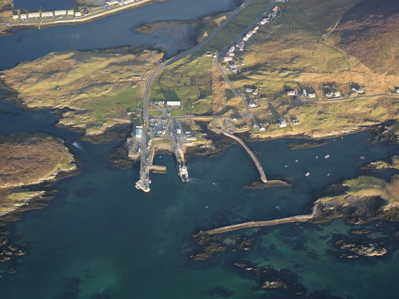 Oblique aerial view of the remains of a fish trap, head dyke and lazy beds near the village of Leverburgh, Harris, taken from the WSW.