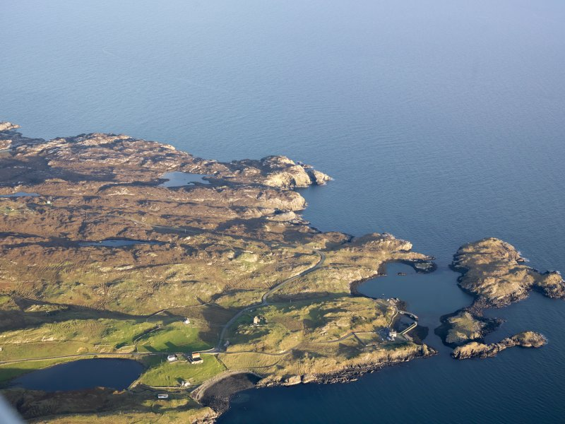 General oblique aerial view of the remains of the township of Rodel and the nearby remains of nausts, elnclosures, a head dyke and lazy beds, Harris, taken from the W.