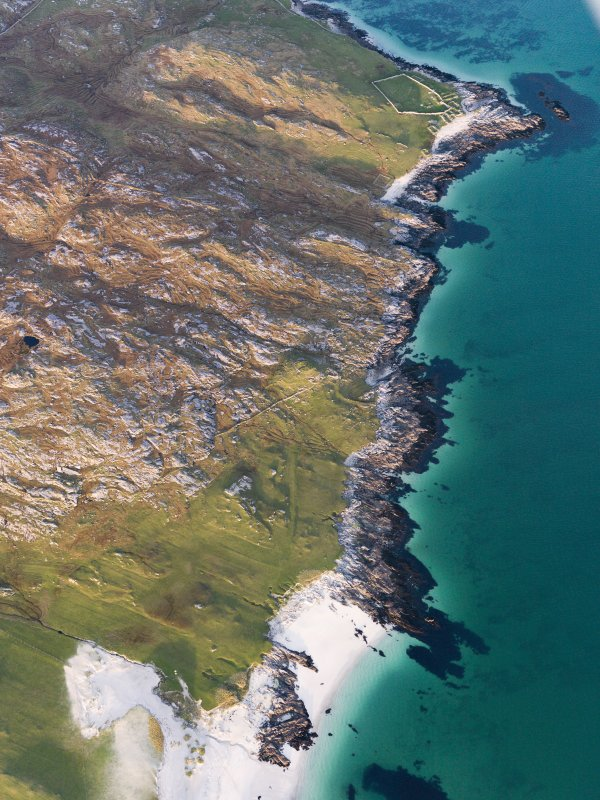 General oblique aerial view of the remains of a Dun at Clett An Duin, the remains of the township of Raah and the nearby dykes and lazy beds, Taransay, Harris, taken from the SW.