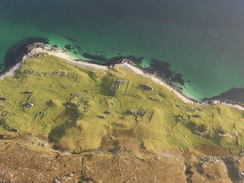 Oblique aerial view of the remains of the township buildings, field boundaries and lazy beds on Scarp, off the Isle of Harris, taken from the W.