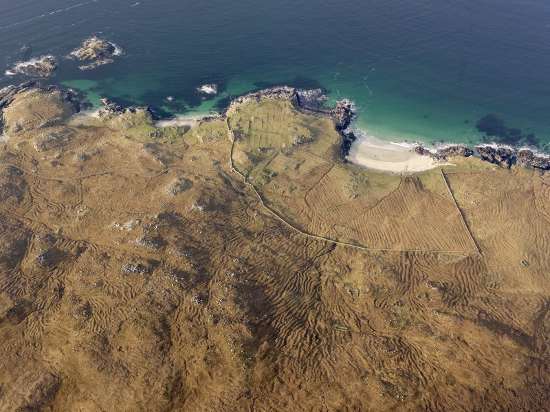 Oblique aerial view of the remains of the head dykes, lazy beds and buildings at Mealista, taken from the E.