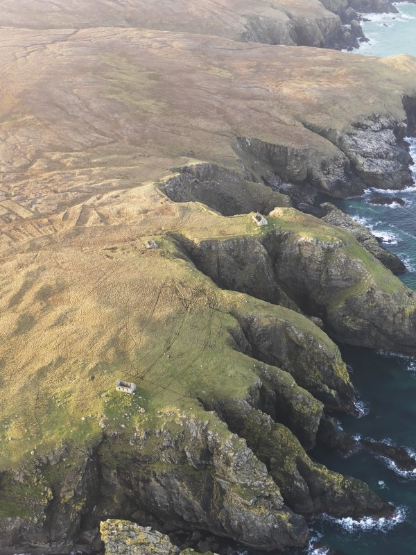 General oblique aerial view of the buildings at Uamh'a Ghobha and Dun Bhilascleitir on the Isle of Lewis, taken from the ESE.