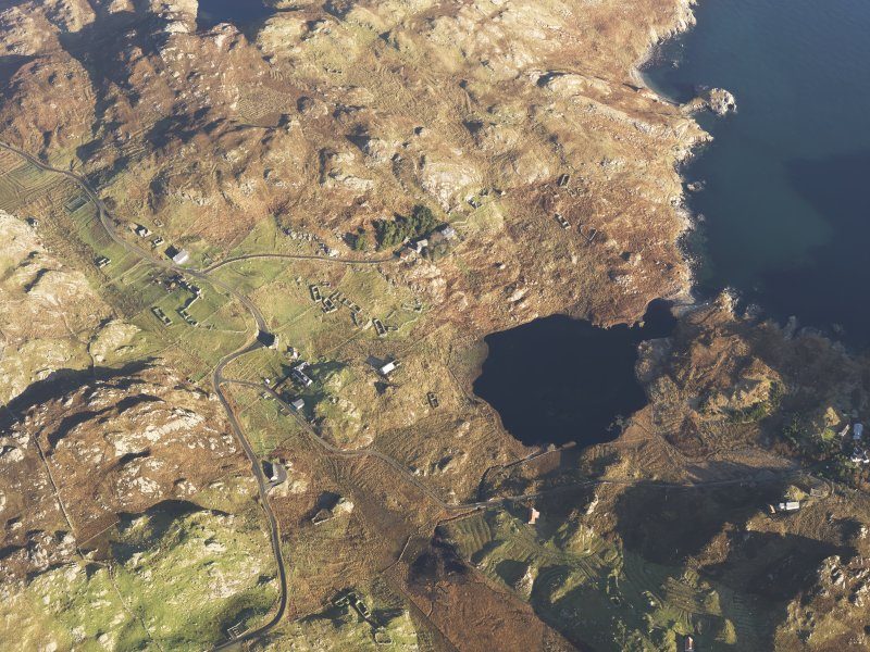 Oblique aerial view of the remains of the township, head dyke and lazy beds at Calbost, Loch Dubh, Lewis, taken from the SW.