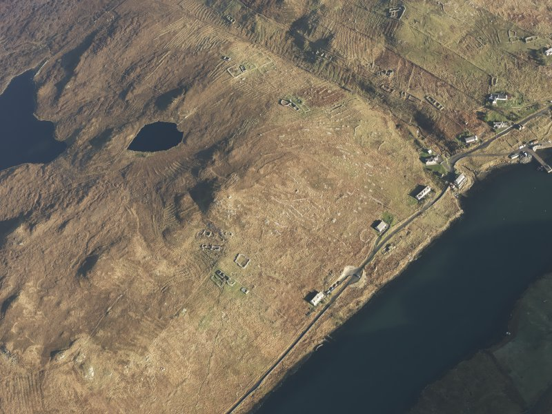 Oblique aerial view of the remains of the township, field system and lazy beds at Gravir, Lewis, taken from the SW.