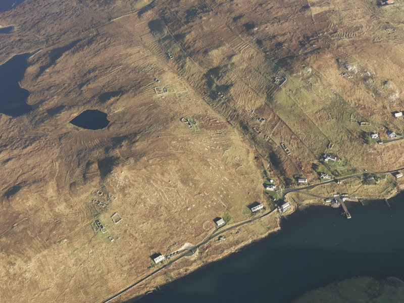 Oblique aerial view of the remains of the township, field system and lazy beds at Gravir, Lewis, taken from the SSW.
