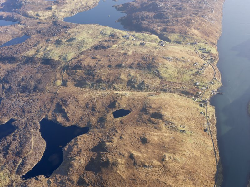 General oblique aerial view of the remains of the township, head dyke, field system and lazy beds at Gravir, Lewis, taken from the W.