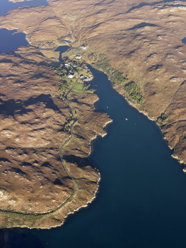 General oblique aerial view of the remains of the township, dam and water management system at Eishken, Loch Eisgen, Lewis, taken from the S.
