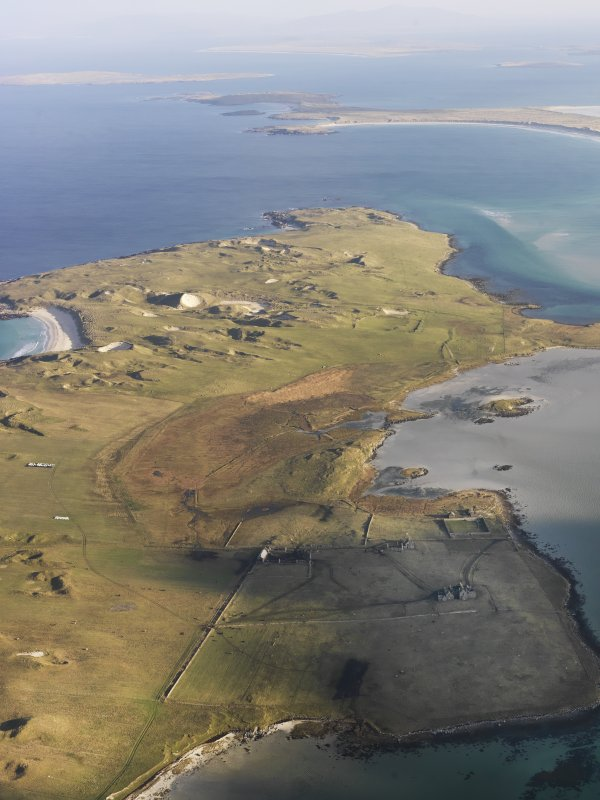 General oblique aerial view of the remains of Vallay House and Old Vallay House, Vallay, North Uist, taken from the SSW.