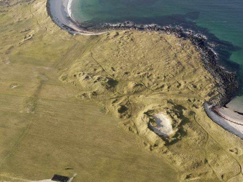 Oblique aerial view of the remains of the settlement at the Udal, North Uist, taken from the E.
