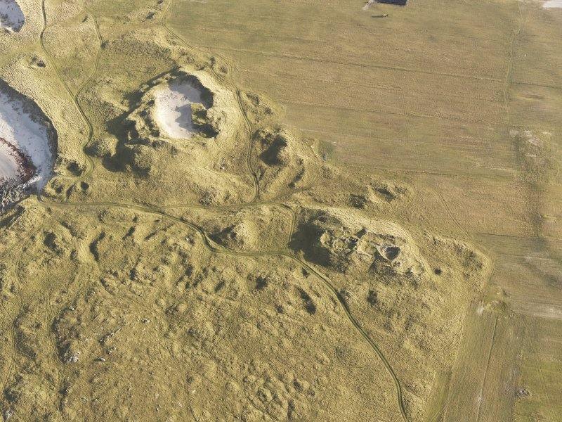 Oblique aerial view of the remains of the settlement at the Udal, North Uist, taken from the W.
