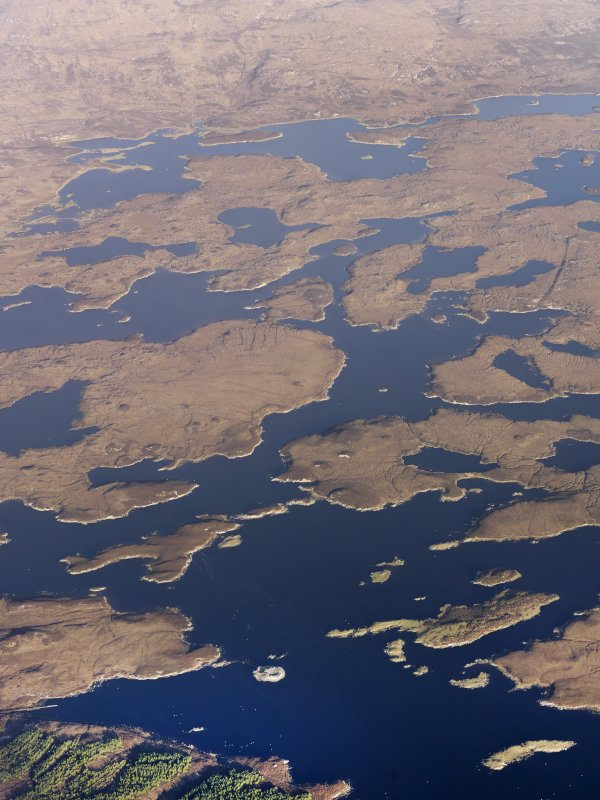 General oblique aerial view of Loch an Duin and the location of the remains of the duns and broch, North Uist, taken from the SSW.