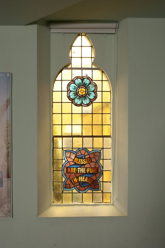 Interior. View of small stained glass window on east wall.