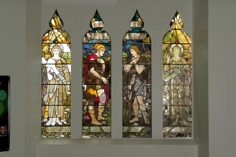 Interior. View of four panelled stained glass window on west wall.